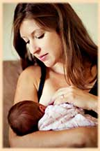 woman breastfeeding a newborn delivered by Dawn Dana, certified midwife in Ventura and Santa Barbara